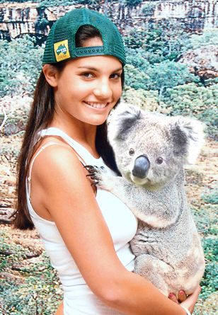 Cute Girl Hugging Koala to Her Chest